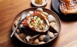 Matilda 159 Dressed spanner crab, prawn butter, flat bread served in a open crab shell